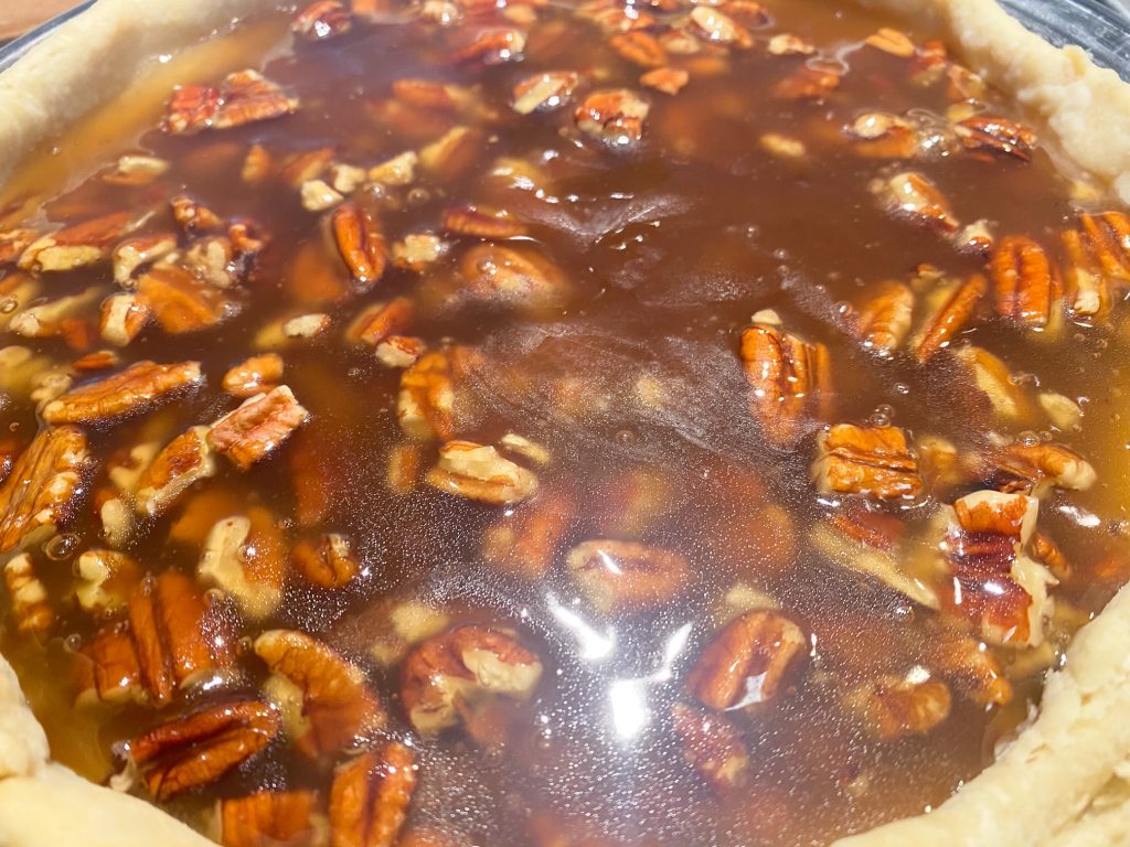 vegan pecan pie filling in prebaked pie crust