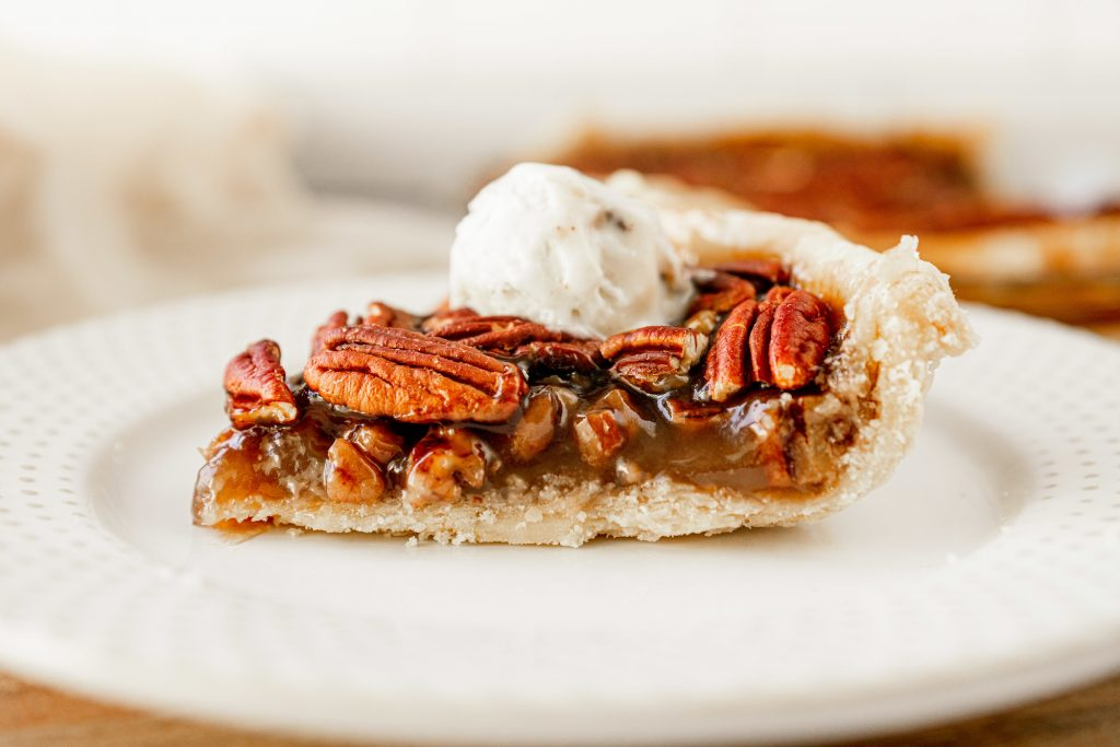 side of the pecan pie that is vegan with ice cream