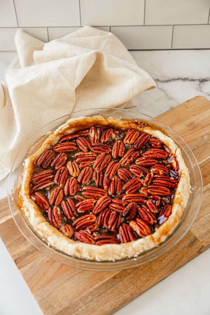 full vegan pecan pie on plate