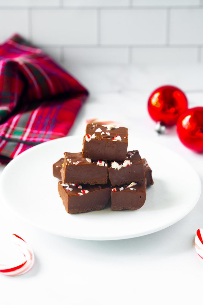 vegan peppermint fudge on serving dish with crushed candy canes
