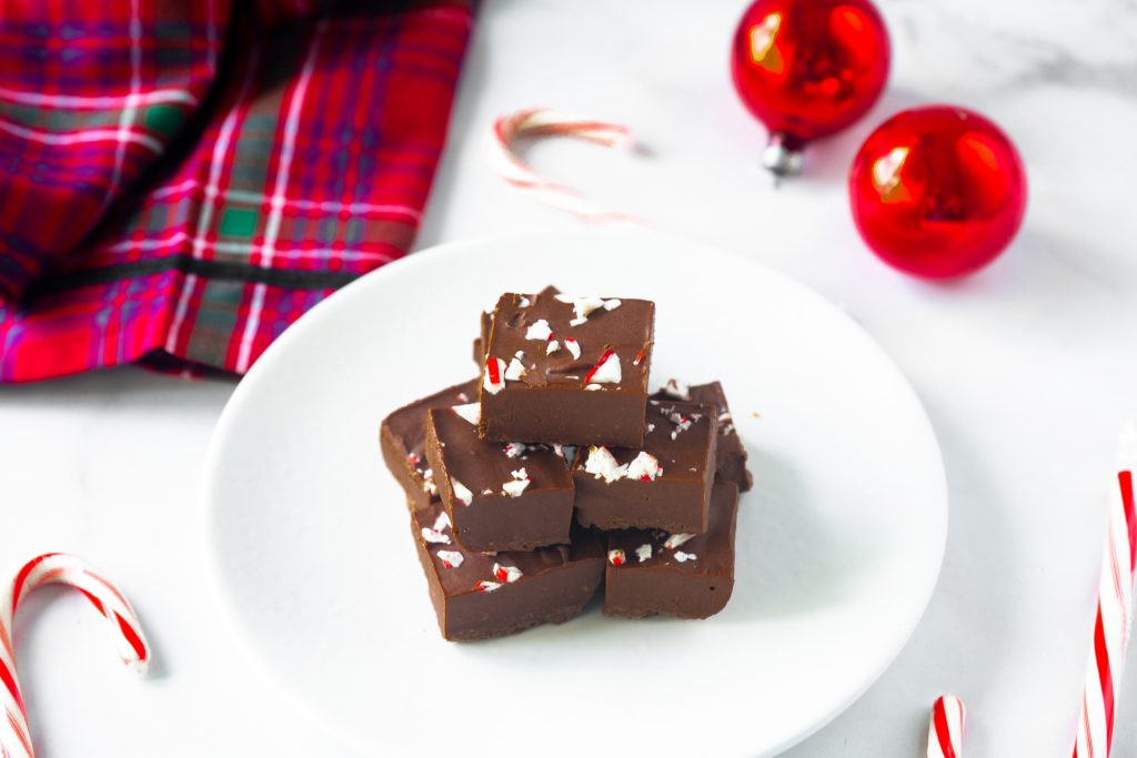 vegan peppermint fudge on serving dish with candy canes