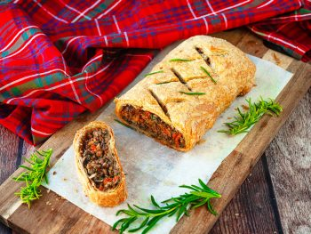 vegan wellington on cutting board with rosemary
