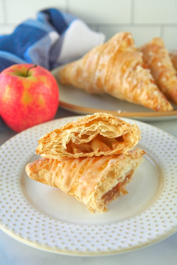 vegan apple turnovers cut in half so you can see the inside
