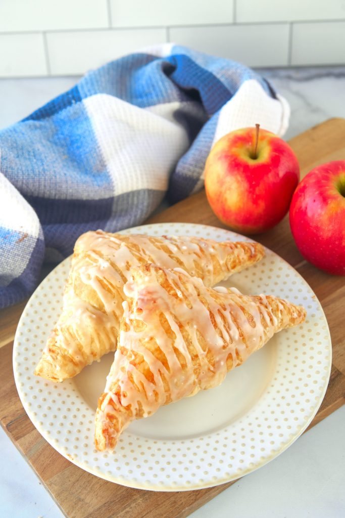 two vegan apple turnovers on plate