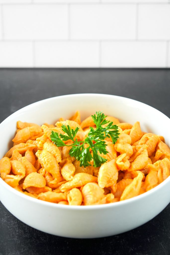 vegan butternut squash mac and cheese with large piece of parsley on top