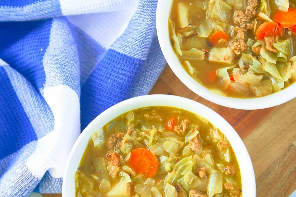 two bowls of vegan cabbage soup on serving tray