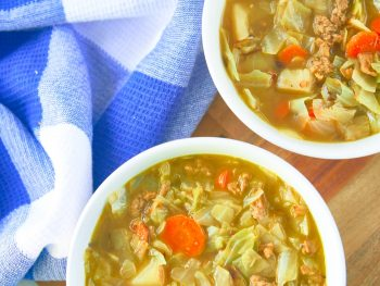 two bowls of rustic vegan cabbage soup