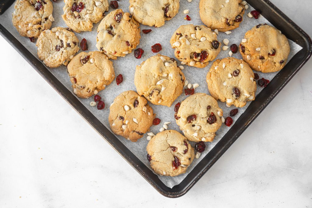 sheet of vegan cranberry cookies with white chocolate chips