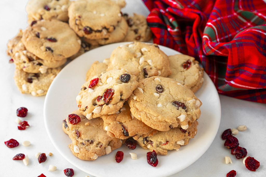 stacks of vegan cranberry cookies with white chocolate on serving dish