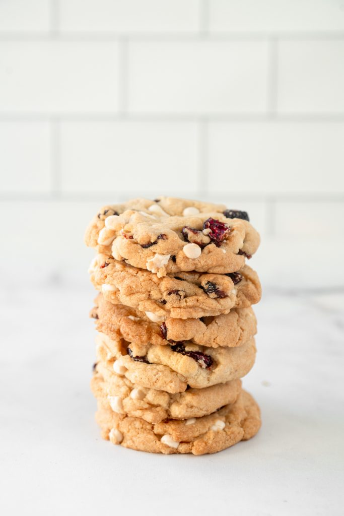 vegan white chocolate cranberry cookies stacked