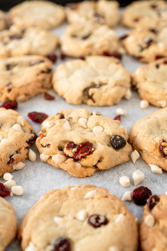 vegan cranberry cookies with white chocolate chips on baking sheet