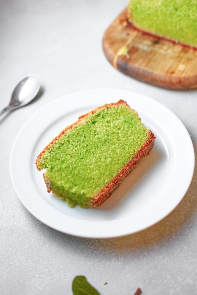 close up of a slice of moist vegan matcha pound cake