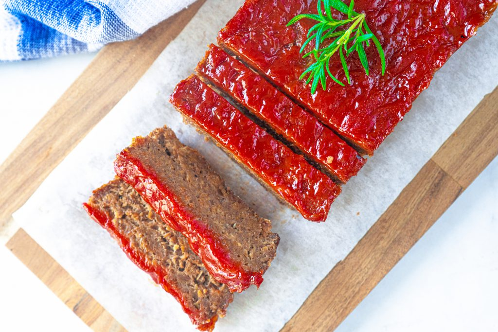 vegetarian meatloaf from above with slices and rosemary
