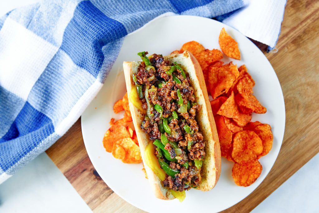 vegan philly cheesesteak from above with BBQ potato chips
