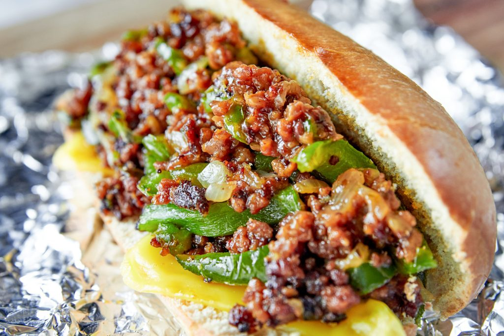 vegan philly cheesesteak with vegan fake meat and green peppers