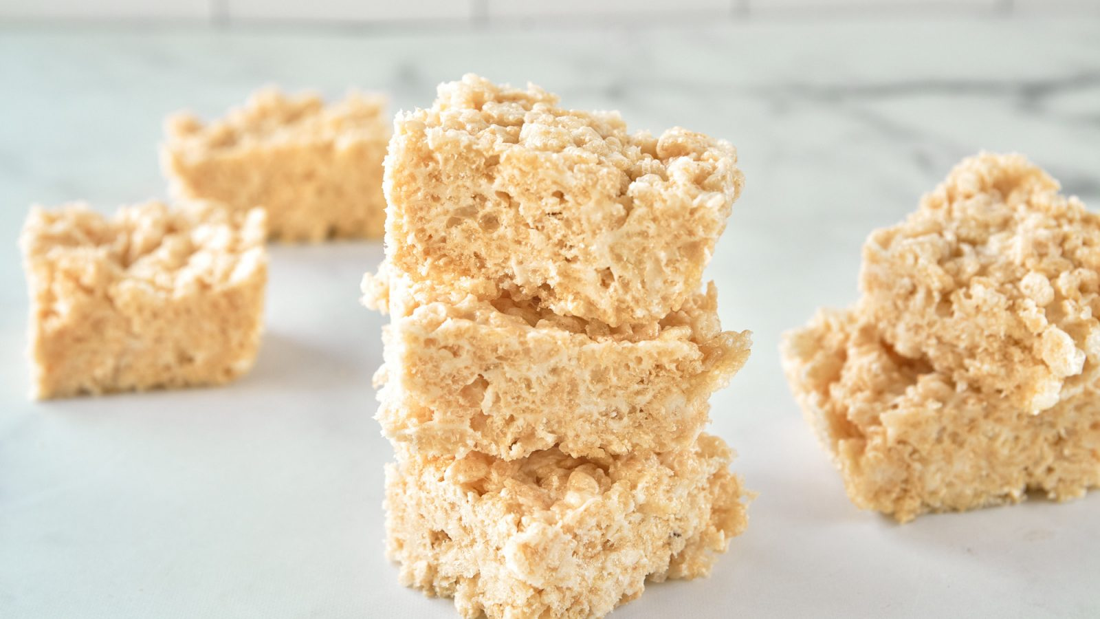 vegan rice krispie treats stacked on the counter