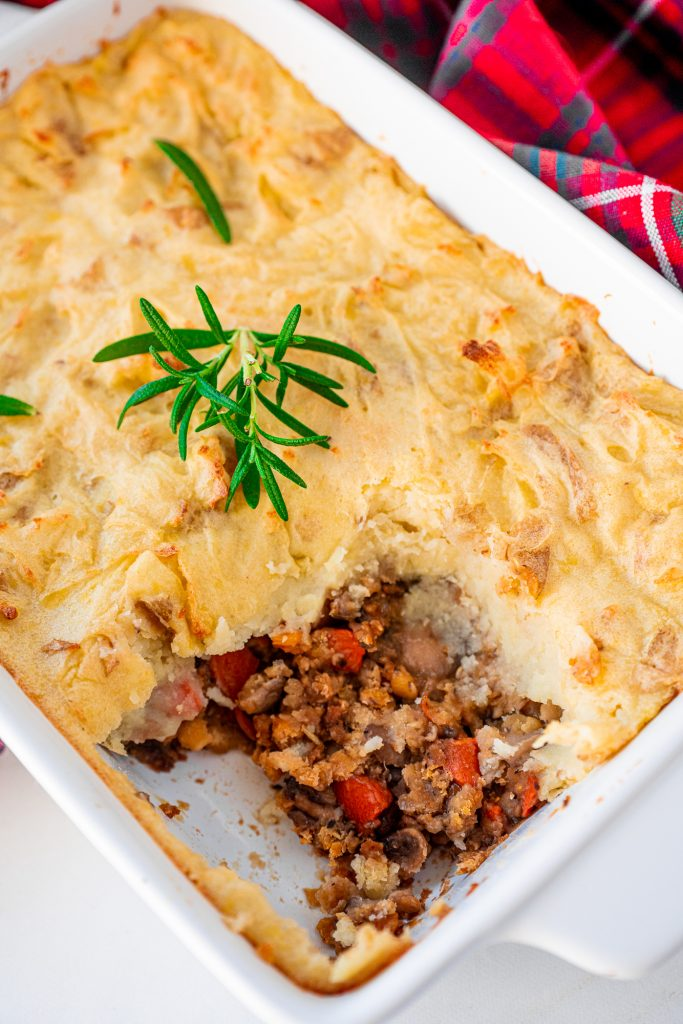vegan shepherd's pie in casserole dish with fresh rosemary