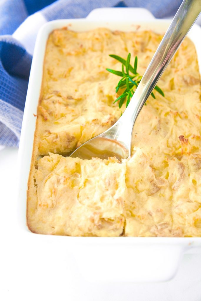 vegan shepherd's pie being scooped out of casserole dish