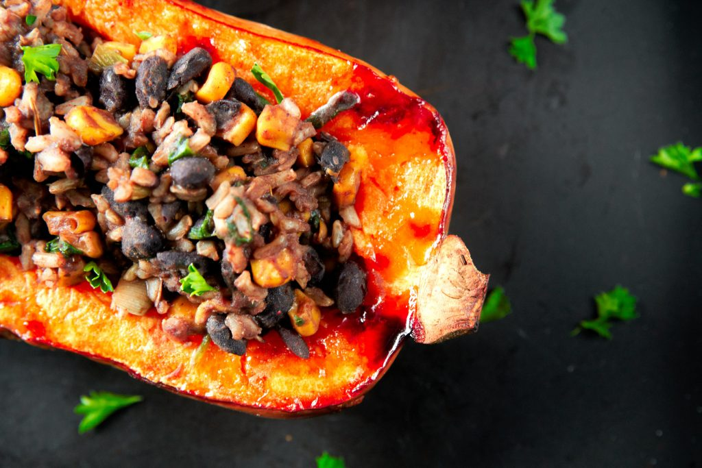 close up of roasted and stuffed vegan butternut squash