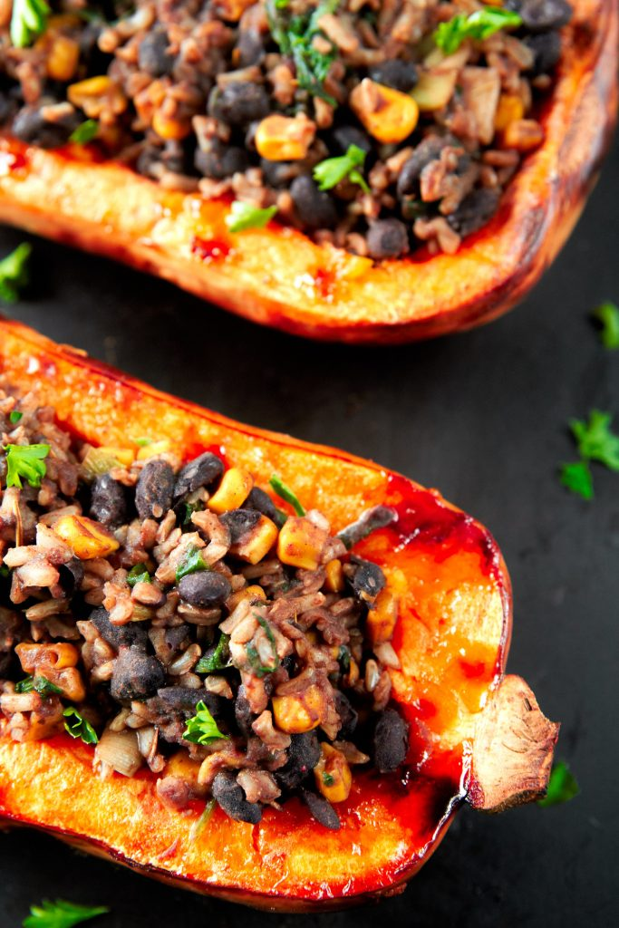 close up of the side of a stuffed butternut squash that is vegan