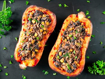two vegan stuffed butternut squashes with parsley