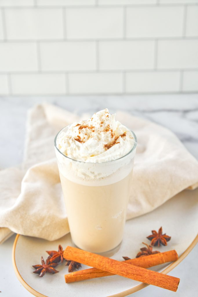vegan copycat chai frappuccino on a plate with cinnamon and cloves