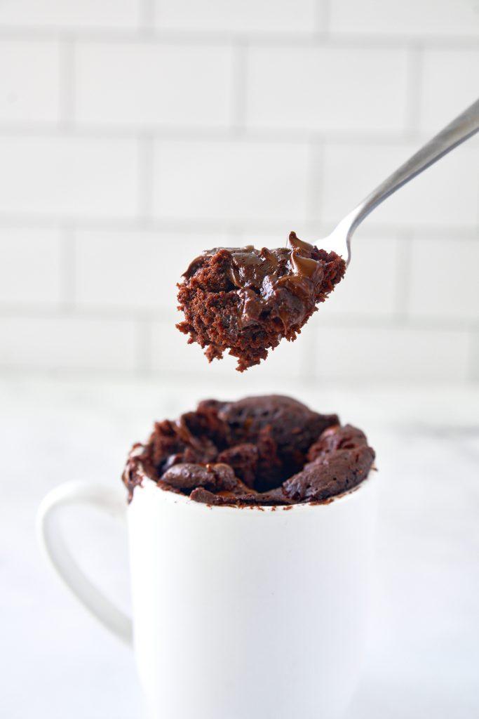 scoop of vegan chocolate mug cake on a spoon