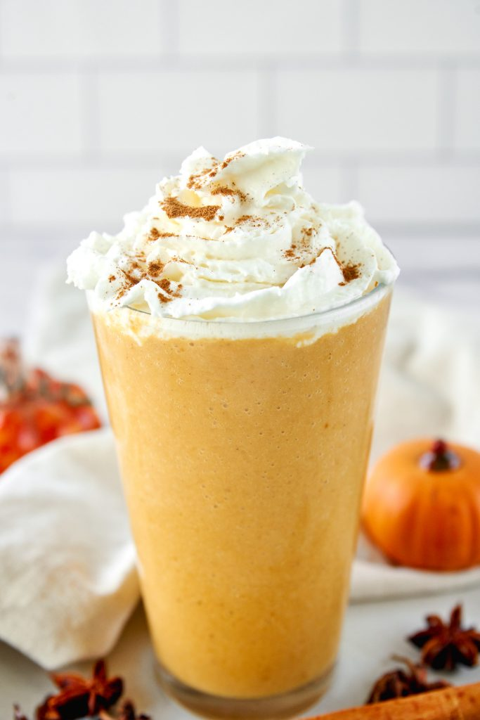 close up of A copycat pumpkin spice frappuccino with whipped cream