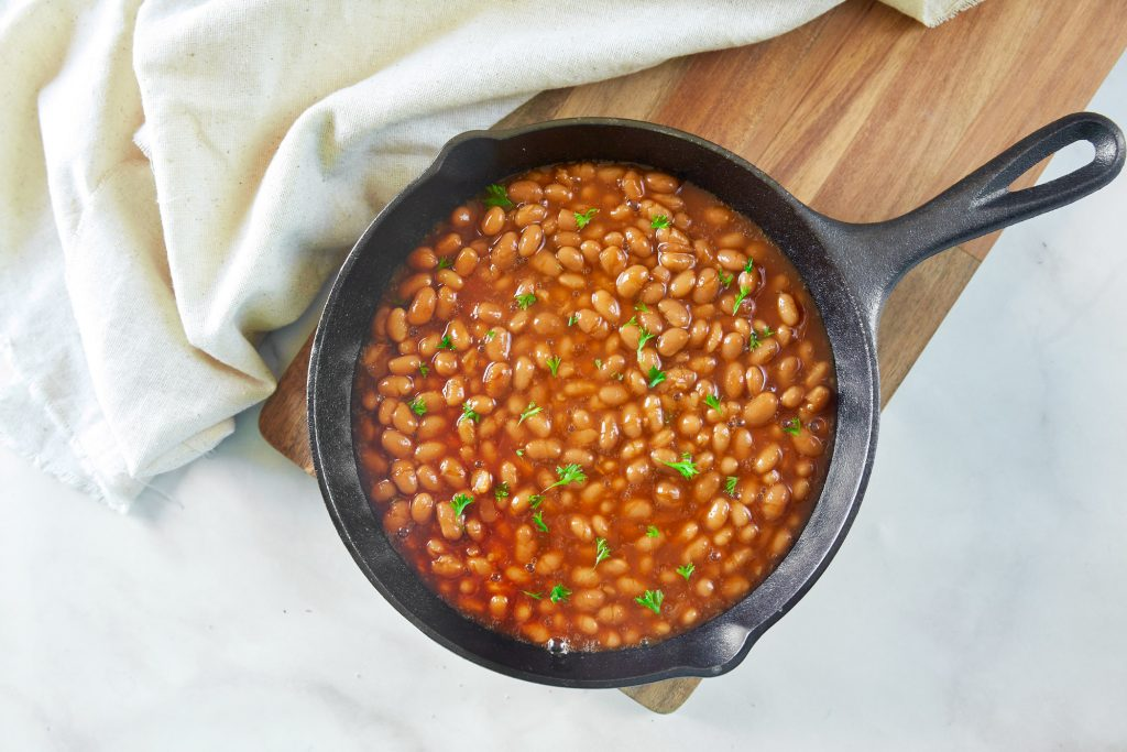 easy vegan baked beans in a cast iron skillet