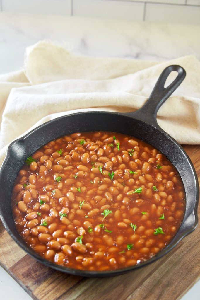 vegan baked beans recipe being made in a cast iron skillet
