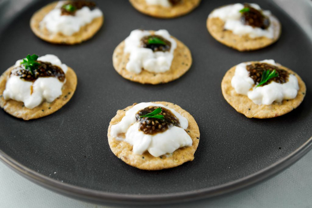 vegan caviar being served on crackers