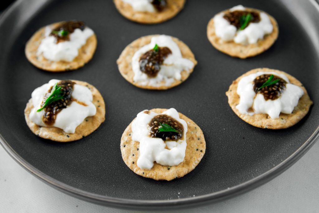 multiple crackers with vegan caviar on it