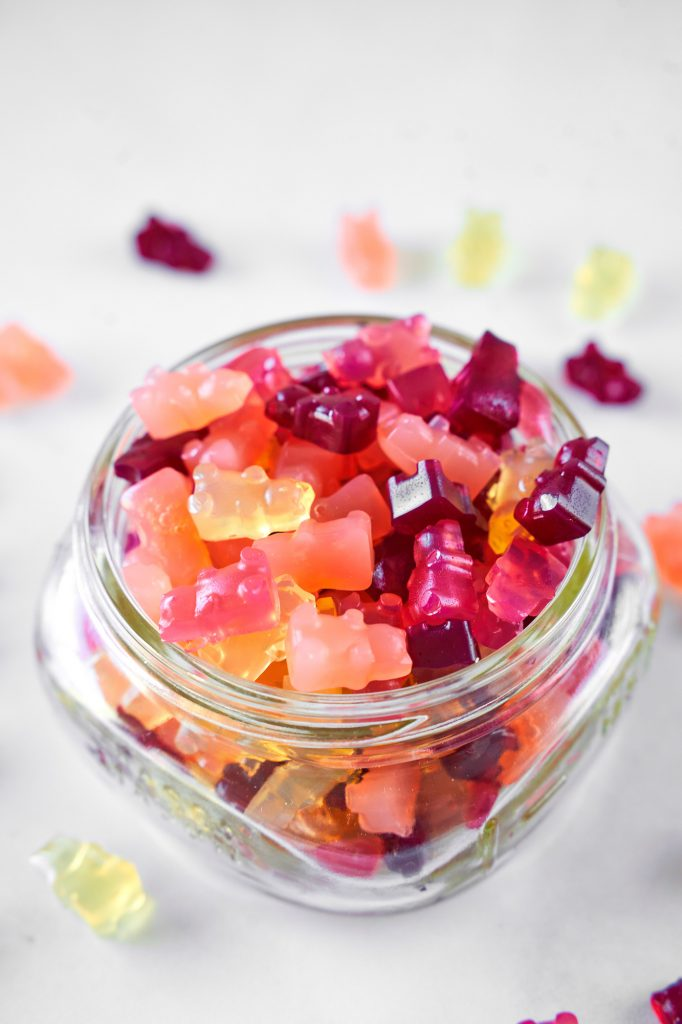 close up of vegan gummy bears in a small jar