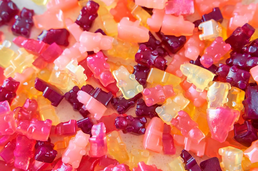 bunch of agar agar gummies on a plate in varying colors