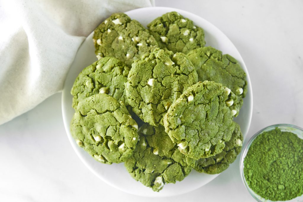 tray of vegan matcha cookies with a bowl of matcha green tea powder
