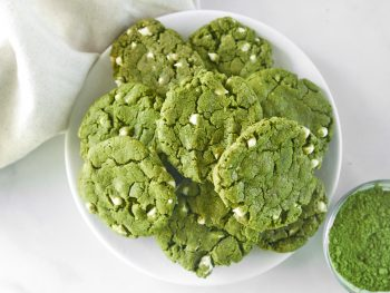 vegan matcha cookies on tray with matcha green tea powder in bowl