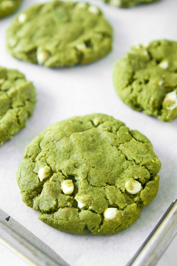 close up of matcha white chocolate cookies on cooling rack