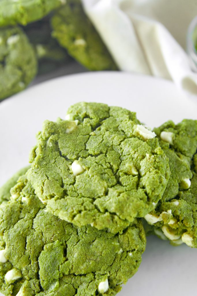 close up of matcha white chocolate cookies on serving plate