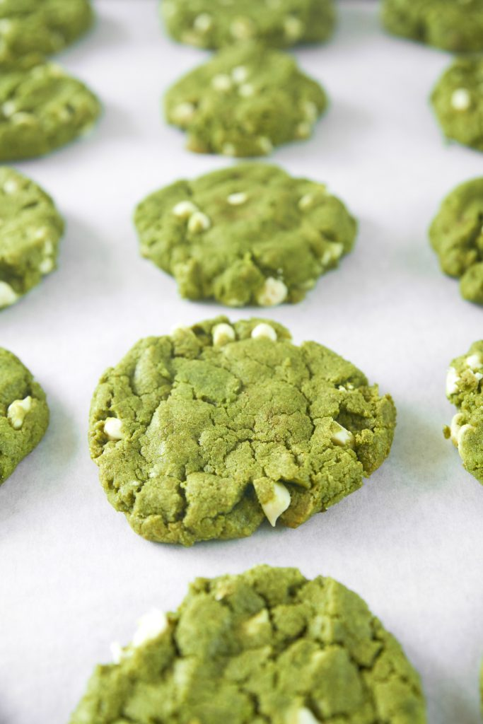 vegan matcha cookies with white chocolate chips on baking tray
