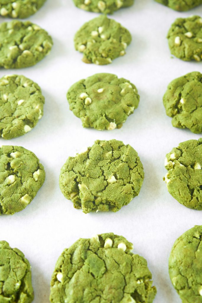 lots of vegan matcha cookies cooling on tray