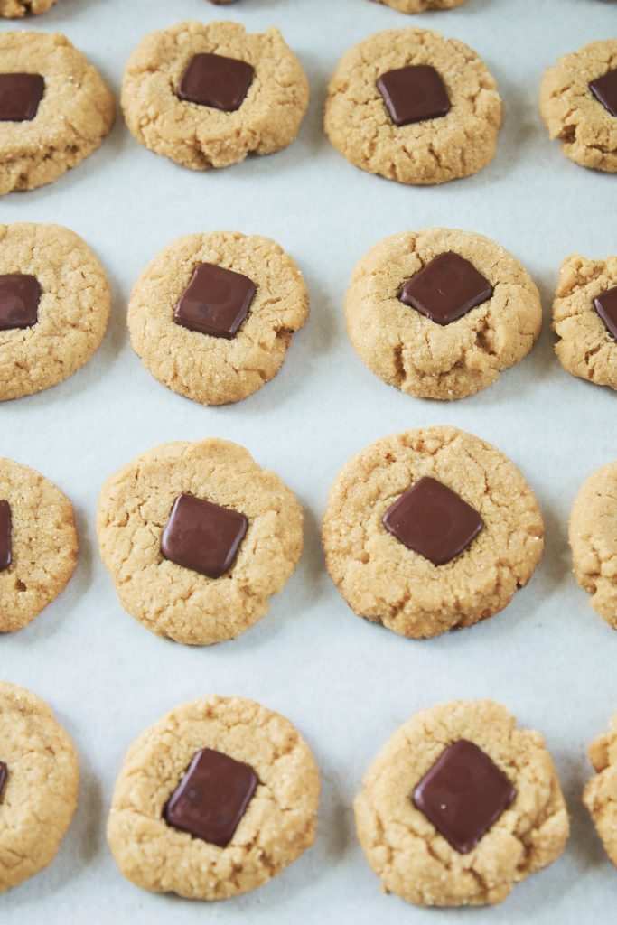 vegan peanut butter blossoms cooling on cookie sheet