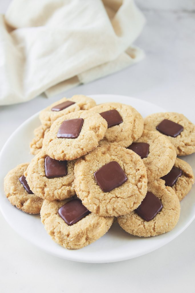 vegan peanut butter blossoms stacked on a plate