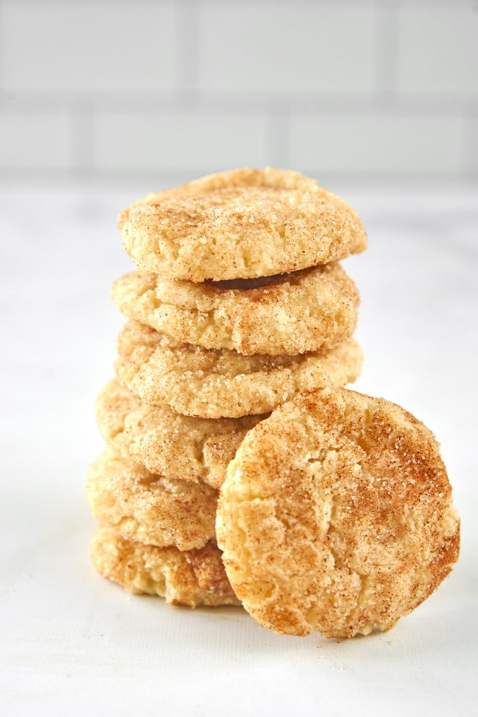 vegan snickerdoodles stacked on a counter