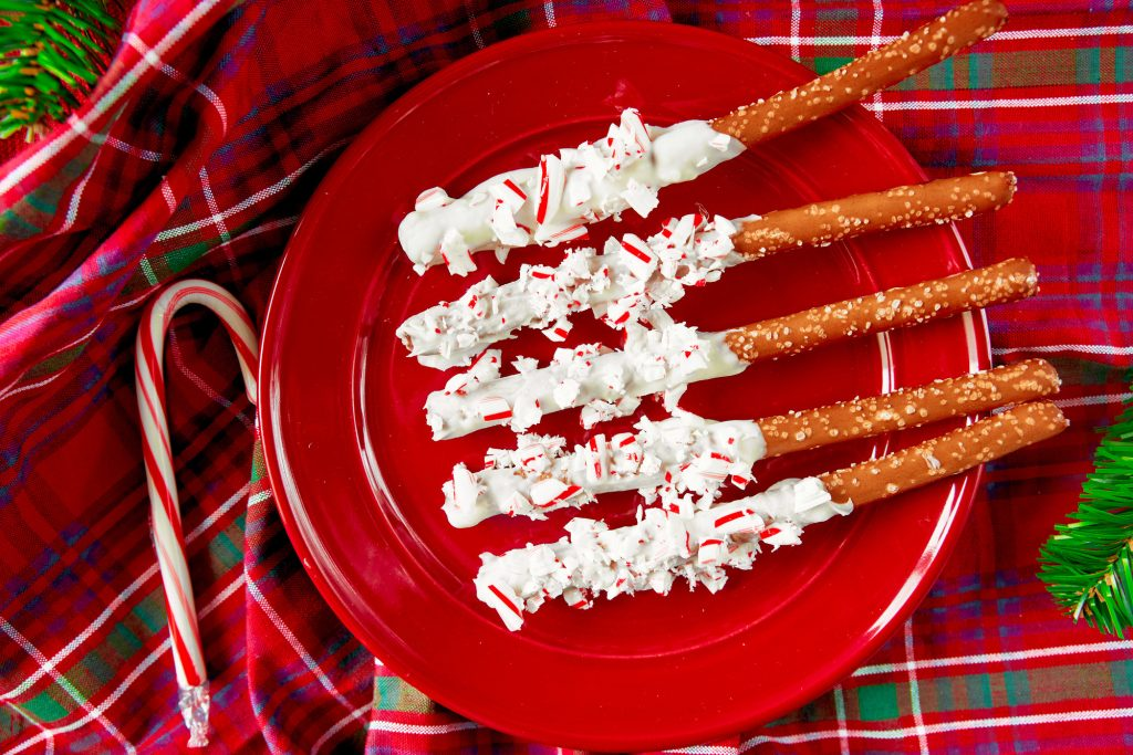 overhead shot of christmas pretzel rods rolled in peppermint