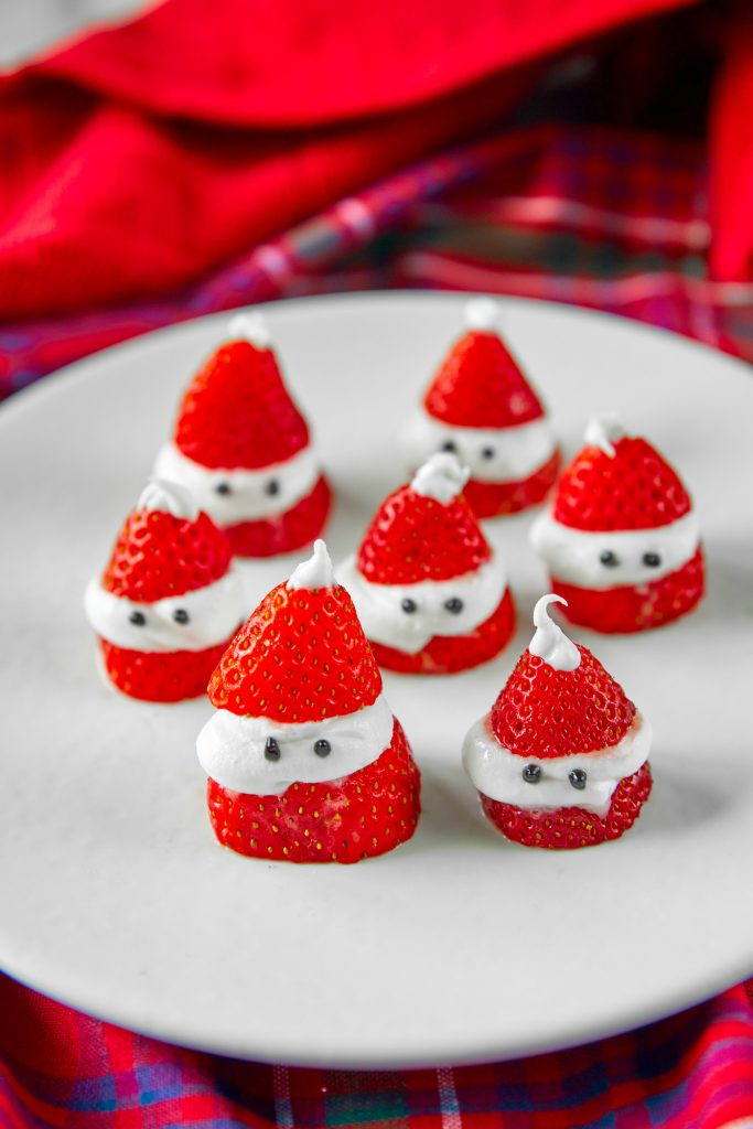 santa strawberries on a red tartan background