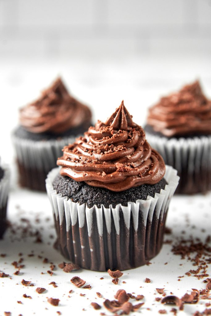 vegan chocolate cupcakes with chocolate shavings