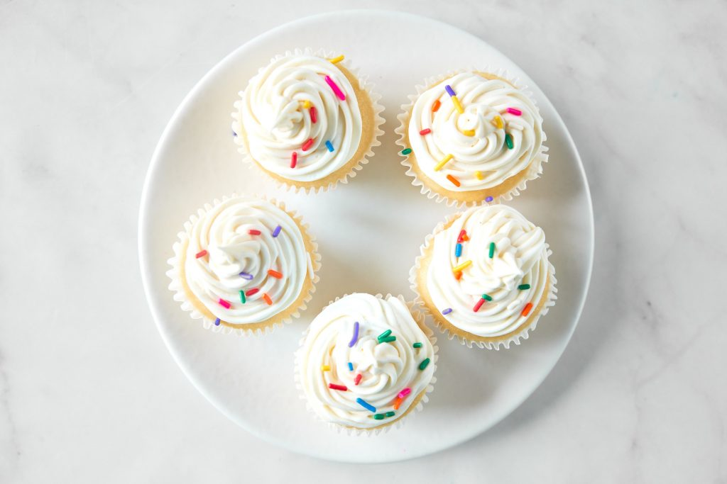 vegan vanilla cupcakes with sprinkles from above
