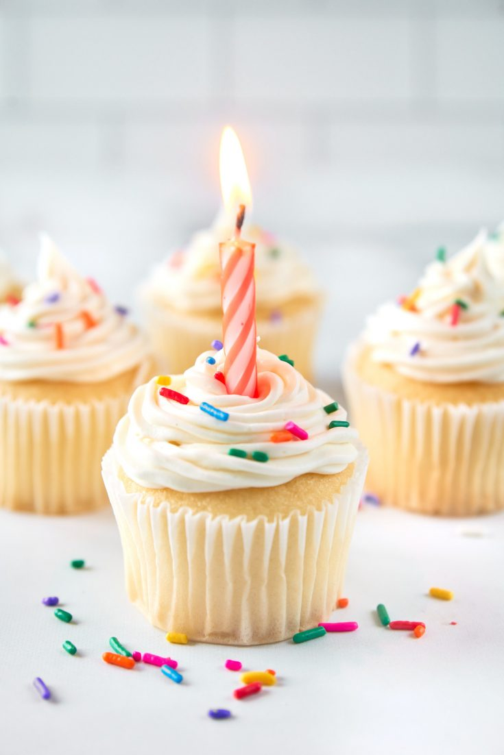 vegan vanilla cupcakes with a birthday candle in it