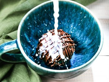 hot chocolate bomb getting non-dairy milk poured on it