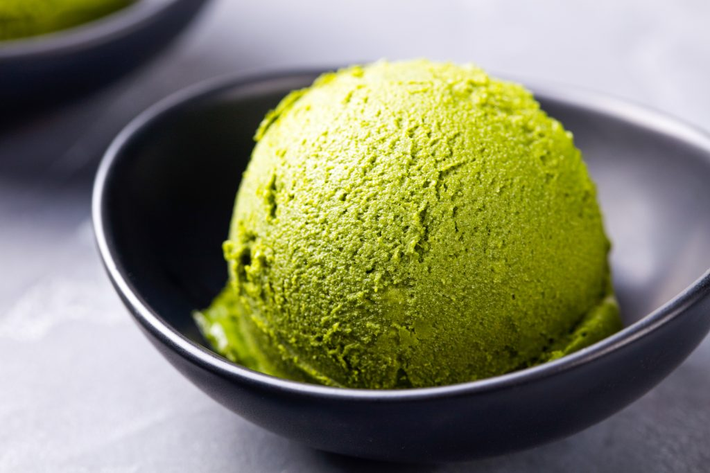 vegan green tea ice cream in a black bowl